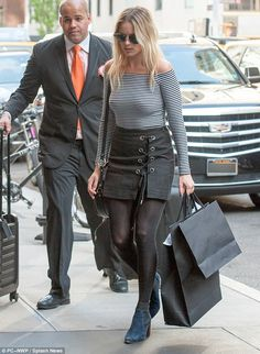 Margot Robbie goes braless in black and white off-shoulder blouse in New York | Daily Mail Online
