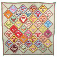 "Vintage Hand Stitched Basket Sampler Quilt, 84 x 86"".  Various printed and plain patches, double sawtooth border .  Sold at auction (Conestoga Auctions)"
