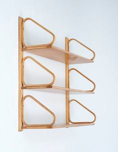 Alvar Aalto Wall-Mounted Shelves   From a unique collection of antique and modern shelves at https://www.1stdibs.com/furniture/storage-case-pieces/shelves/