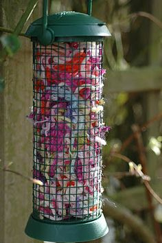 Save all your crochet scrap odds and ends and chopped them up and put in a bird feeder for the birds to take for their nests. How pretty does that look!  They'll have the cosiest nests in the neighbourhood :)