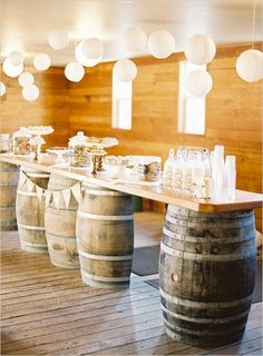 Make your own rustic drink station with barrels, wood + accents from Weddingstar {we have the paper lanterns and so much more!}.