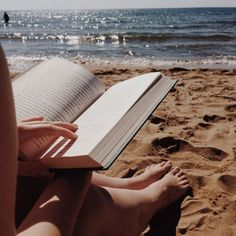 Reading...toes in the sand,sun on my face.Checking out the water between pages.