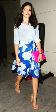 Emmy Rossum dined out in a delightfully chic getup—she styled her blue floral full skirt with a relaxed Oxford shirt (with the sleeves casually rolled up), a playful hot pink Kate Spade Saturday envelope clutch and nude ankle-strap sandals. #InStyle