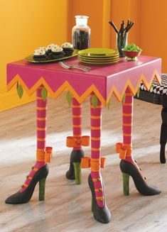 "Supported by whimsical, yet sturdy, witch legs...  I'd love to do my front port ""whimsical"" next year, painted chairs and painted flower pots and a table like this.  Oh I would just love it!"