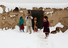 Afghan Children battle against cold and snow