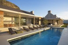 A dream holiday house for sale in South Africa: Numerous covered outdoor entertaining areas surround the 16 metre pool.