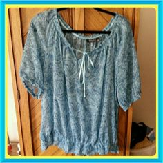 Blue print on darker blue background.  Sheer A beautiful sheer peasant top with blue print on blue background. Would work well paired with a camisole. Drawstring neck tied with a satin ribbon. Elasticized sleeves and lower headline. Light and airy ......perfect for spring and summer! Comes from a pet and smoke free home. Please ask any questions you may have before you buy. a.n.a Tops Blouses
