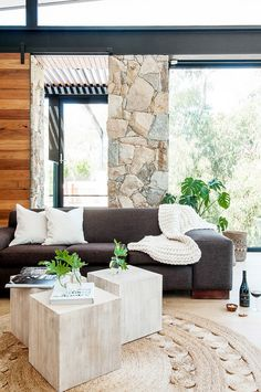 7 Ways To Create A Warm Living Room // Bring in cozy textiles like blankets and pillows.