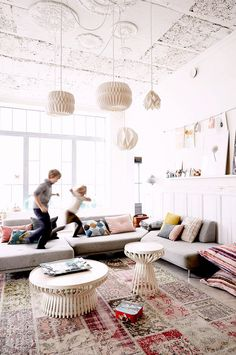 French photographer Pascal François transformed a former waffle factory into a sprightly home for his wife and children. With low-slung sofas (great for jumping on!), round coffee tables (free of sharp corners), and giant floor cushions, his living room might be the perfect family space. His children enjoy it; that's for sure.