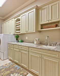 add beadboard and cap molding to fronts of cabinets? -- Teri Turan - traditional - laundry room - atlanta - Teri Turan