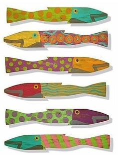 painted fish on fence pickets | Featured in Coastal Living Magazine