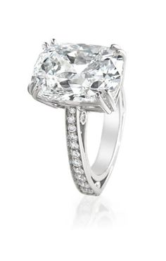 Chairman's Imperial Engagement Ring. An 18 karat white gold diamond cathedral engagement ring containing a cushion cut diamond weighing 2 carat, E VS1, with 92 round brilliant cut diamonds weighing 0.79 carats, G VS