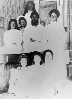 Rasputin with Tsarina Alexandra Fyodorovna, her children and their nurse