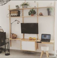 Svalnas Shelves with TV and laptop