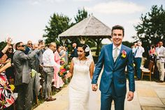 Bride and groom showered with confetti after an outdoor wedding - © Samuel Docker Photography