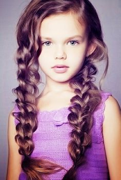 long braided red hairstyle for little girl.