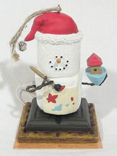Getting ready for Christmas, Santa is busily painting toy boats. From the…