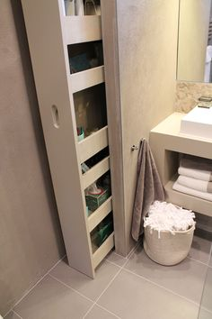 I would like a storage closet that has doors/shelves on the upper part, and pull-out storage on the lower half to store cleaning supplies for the bathroom in addition to toilet paper etc.
