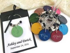 Music Themed Wedding Favors, CUSTOM COLOR Chalkboard Wine Glass Charms with Sheet Music Paper Beads, Music Wedding Decorations, Music Party by AtHomeWithWords on Etsy https://www.etsy.com/listing/467898177/music-themed-wedding-favors-custom-color