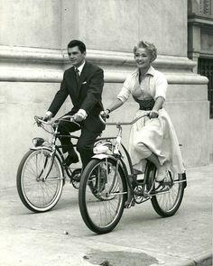 Edward Purdom and Jane Powell ride bikes.......Uploaded By  www.1stand2ndtimearound.etsy.com