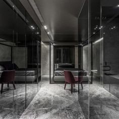 awesome-bedroom-in-black-design-with-black-bed-and-black-marble-floor-black-marble-wall-glass-transparent-wall-red-chair-black-curtain