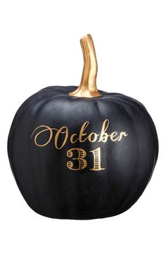 The date of Halloween scrolls across this matte pumpkin decoration in gleaming goldtone letters.