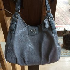 Grey Coach Maggie shoulder bag purse- Purchased new from Macy's- great organization . Grey silver material and leather shoulder bag. Comes with all the paper work. Stands 10 inches tall and 13 inches wide. Great condition- no damage. I wore it probably 4 times to the office. Coach Bags Shoulder Bags