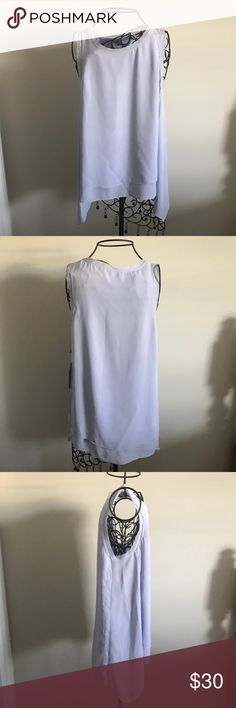 """Lavender Sleeveless Top. Beautiful color. New with tags. 100% polyester. Work wear, dress up or casual wear. Size small. Measurements lying flat: armpit to armpit 18"""" length of front 24"""" and length of back 27.5"""".  ❌ No trades or off Poshmark transactions.   👌🏻Quick shipping.   💁🏻Offers welcome through """"Make an Offer"""" feature.   👗👠 Bundle discount.   ❔ Feel free to ask any questions. Simply Vera Vera Wang Tops Tank Tops"""