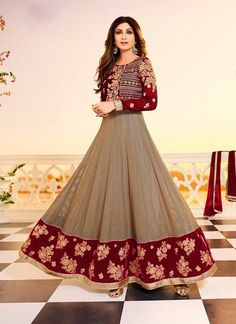 Get the effortlessness and beauty with this Shilpa Shetty maroon jacquard and sparkle georgette anarkali salwar kameez. This clothing is wonderfully enhanced with weaved and patch outskirt work. Accompanies coordinating base and dupatta.
