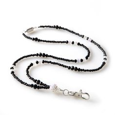 This fashion lanyard combines a touch of the wild west with a huge dose of modern rodeo style in order to offer a design that is perfect for everyday wear. The lanyard is beaded with clear and black beading and then joined together with a large rhinestone-encrusted globe.