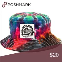 8f594d5bbb5 Hit the beach with some groovy shade courtesy of the Milkcrate rainbow tie  dye bucket hat. Shade your face in style with a black tie dye colorway