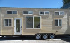 This 30' tiny house is ready for off-grid living! Includes a 1000-watt solar kit with batteries, 60 gallon water tank, and a composting toilet.