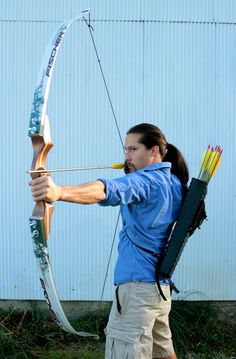 Recurve bow (Creon was the one that taught her archery)
