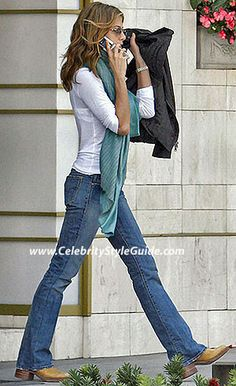 proof that white shirt, jeans, cowboy boots always is in style.