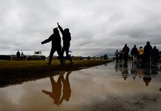 May 3, 2013 - Music fans traipse through the mud at the FedEx Stage during the first night of Beale St. Music Fest at Tom Lee Park. (Mark Weber/The Commercial Appeal)
