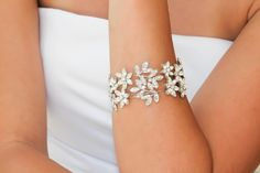 The stunning LUCETTE bridal cuff bracelet is handcrafted with Swarovski Crystals encrusted onto a dramatic botanical design. The unique and intricate de. Bridal Cuff, Bridal Bracelet, Peacock Feathers, Wedding Jewelry, Swarovski Crystals, Jewlery, Bracelets, Pretty, Handmade