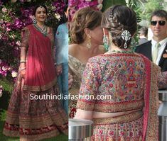 At her son Akash Ambani's wedding, Nita Ambani was seen in an intricate beige and pink lehenga by Sabyasachi. Her look was rounded out with a statement diamond and emerald necklace set and a braided bun! Sleeve Designs, Blouse Designs, Nita Ambani, Pink Lehenga, Dress Indian Style, Indian Wedding Outfits, Anarkali Dress, Sabyasachi, India Fashion