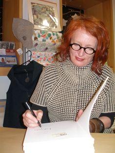 Nina Saunders signing copies of 'Nina Saunders: Katy's Convoy' in 2010 Book Signing, Hand Knitting, Sculpture, Artist, Hand Weaving, Artists, Sculpting, Sculptures, Statue