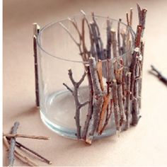 Glue twigs to candle holder