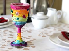 Cute craft for Passover - Elijah's Cup with Mod Podge or craft glue, yarn and embellishments.