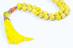 Yellow mala necklace Howlit ,Mala glass beads.yellow Howlite mala,inner peace mala,yellow Tassel Necklac ,spiritual gift. karma yoga jewelry The sunny Yellow color of Howlite beads will help you find inner peace. Carnelian will help you find strengthens creativity. The oraneg Agate is