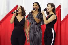 """Phillipa Soo, Rene Elise Goldsberry & Jasmine Cephas Jones of Hamilton: Singers of the cast of Hamilton, Phillipa Soo (R), Rene Elise Goldsberry (C), and Jasmine Cephas Jones (L) sing """"God Bless America"""", before the NFL Super Bowl 51 football game between the New England Patriots and the Atlanta Falcons on Feb. 5, 2017."""