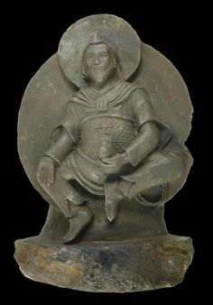 Ancient Buddhist statue made of ataxite (iron) meteorite.