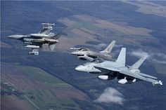 CF-18 Hornet from the Canadian Air Task Force Lithuania was airborne with Portuguese F-16 Falcons over Lithuania a few days ago. The flight was part of the NATO Baltic Air Policing mission, which in turn is part of Operation REASSURANCE. Photos by Cpl Gabrielle DesRochers