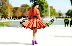 Twirling the skirt of her orange coat in purple heels and a pork pie hat in Paris. Orange Dress, Orange And Purple, Zac Posen, Love Fashion, High Fashion, Womens Fashion, Paris Fashion, Street Fashion, Trends