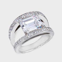Modern+Zirconia+Rings | ... classic emerald cut cubic zirconia ring set between a split band