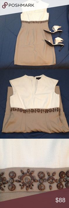 Tahari Arthur S. Levine Beaded Waist Dress This Tahari Arthur S. Levine mini dress features a white top and beige knee length bottom, separated by fun wooden beadwork. Brand new condition! Classy yet casual, this can be dressed up or down with the right accessories. Bundle with white Sergio Rossi shoes and save! Tahari Dresses Mini