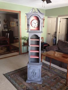 Cute grandfather clock repurpose project.  Clock was just a cabinet shell when I purchased it.  Cute coral and grey finish with a paris flair clock face.