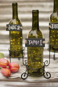 Lights 5 Ways by Dan Doromal Fairy lights encapsulated in wine bottles perfectly adds flavor to tasting parties and Tuscan themed events.Fairy lights encapsulated in wine bottles perfectly adds flavor to tasting parties and Tuscan themed events. Wine Bottle Centerpieces, Wedding Table Centerpieces, Wedding Table Numbers, Flower Centerpieces, Wedding Decorations, Centerpiece Ideas, Centerpieces With Lights, Italian Centerpieces, Box Decorations