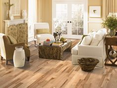 Love how much sunlight this living area gets! Different shades of hardwood flooring to compliment this room.